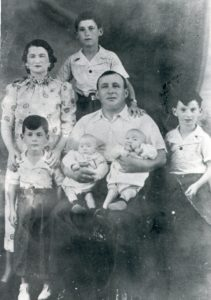 The Szklarz family in 1938. Back row – Jacques. Middle row, left to right – Cecile, Charles, Jean. Front row, left to right, Nathan, Annette & Paulette (unknown which twin is which)